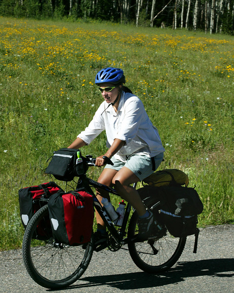 Emily is riding the Tour Divide Trail along the Continental Divide from Jasper, Canada. She's gone over 900 miles so far. In front of Red Rock RV Park, Island Park, Idaho, July 13, 2006.