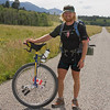 Matt Burney is planning to Unicycle the entire Great Divide Mountain Bike Route to support the Leukemia & Lymphoma Society. Here he poses in front of RedRock RV Park along Red Rock Road in Island Park, Idaho. August 5, 2009