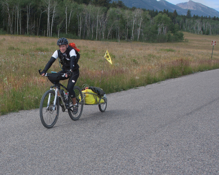 Brent Schmeling from Seymour, Wisconson riding along Red Rock road in Island Park, Idaho on his Tour Divide cycling trip. August 12, 2010.