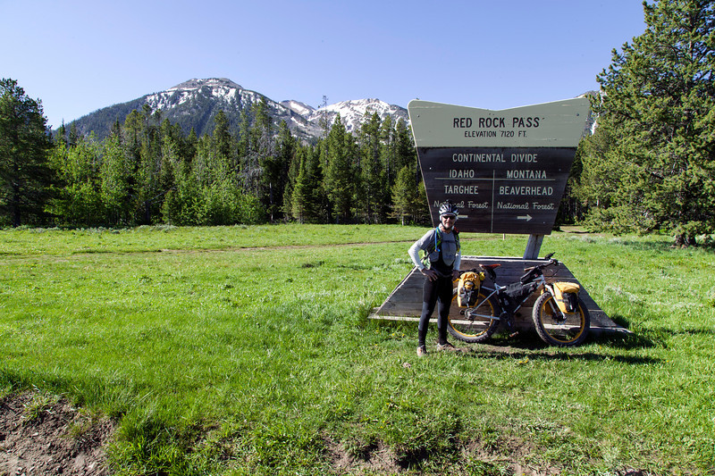 """Brian Managan from Rochester, New York is riding the Tour Divide Bicycle trail from Antelope Springs, NM (Mexican border) to Banff, AB. He left NM on May 21st, 2013 and is actually ahead of his own schedule. He rides a """"Fat Bike"""" with 4"""" wheels. This picture was taken at the Idaho/Montana border along the Continental Divide.  June 23, 2013"""