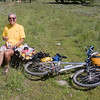 Ken is traveling the Divide Tour From the Canadian Border to the Mexican border with his friend Ed. They are in their late Sixties and still have what it takes to travel the distance.  They are from Ohio. Here he's taking a lunch break on Red Rock Road at the continental divide (Montana/Idaho).