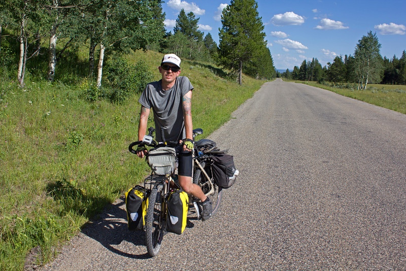 Patryk Morzyszek from Vail, CO is traveling part of the Great Divide Bicycle trail, from Vail to the Canadian border, and then to Seattle and then to Los Angeles.  Here, he is along Red Rock Road in Island Park, Idaho. July 18, 2012.