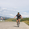 Matt Burney unicycles the entire Great Divide Mountain Bike Route to support the Leukemia & Lymphoma society. Here he poses in front of RedRock RV Park along Red Rock Road in Island Park, Idaho. August 5, 2009
