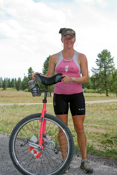 """Gracie Sorbello poses along Red Rock Road in Island Park, Idaho. Gracie is riding her unicycle the entire Great Divide Mountain Bike Route (2745 miles) to support the Leukemia & Lymphoma Society.  <a href=""""http://www.divideby1.com"""">http://www.divideby1.com</a> August 5, 2009"""