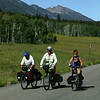 Group of 3 bikers from Missouri riding the Continental Divide Bike Trail (Tour Divide), passing in front of Red Rock RV Park in Idaho. July 2006