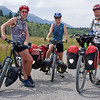 Bikers on the Great Divide Mountain Bike Route on August 13, 2009 in front of Red Rock RV Park in Island Park, Idaho. On the right is Bruce from Helena, MT and in the middle is Carolyn from Utrecht, the Netherlands. On the left is her traveling campanion whose name was not understood. They had been on the road from Banff, Canada for almost 3 weeks.  The east Centennial Mountains of the Rocky Mountain range is in the background.