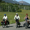 Bikers riding the National Bicycle Trail in front of Red Rock RV Park. Centennial Mountains in the background. Island Park, Idaho.