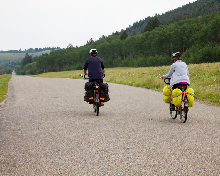 Lyn and Ed Laceby, from Courtenay, B.C. in Canada are riding the Great Divide Bicycle Trail from Banff to the Mexican border. They are taking their time doing it, enjoying the scenery. They spent the night of July 15th, 2012 at the RedRock RV Park, near Island Park, Idaho. They are leaving the RV Park and heading east on Red Rock Road here.