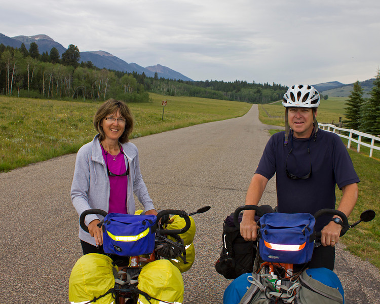 Lyn and Ed Laceby, from Courtenay, B.C. in Canada are riding the Great Divide Bicycle Trail from Banff to the Mexican border. They are taking their time doing it, enjoying the scenery. They spent the night of July 15th, 2012 at the RedRock RV Park, near Island Park, Idaho. The eastern Centennial mountains are in the background as they pose on Red Rock Road.