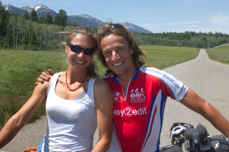 Willemijn Botje (left) and Niels Leenders (right) are riding their bicycles along the route of the Tour Divide from Canada to Mexico. Here they are along Red Rock Road in Island Park, Idaho. They are from the Nederlands. July 1, 2012. The Eastern Centennial Mountains are in the back.