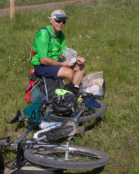 Ed is traveling the Tour Divide from the Canadian Border to the Mexican border with his friend Ken. They are in their late Sixties and still have what it takes to travel the distance.  They are from Ohio. Here he's taking a lunch break on Red Rock Road at the continental divide (Montana/Idaho).