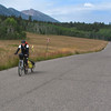 Brent Schmeling riding along Red Rock road in eastern Idaho with Nemesis Mountain in the background (part of the Continental Divide and Centennial Mountains). Brent is riding the Tour Divide Route from Canada to Mexico across the Rocky Mountains solo by bicycle. August 12, 2010. Brent is from Seymour, Wisconsin.