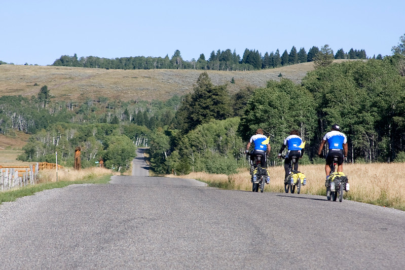 Riding along the Great Divide Bicycle Route (late in the season) from US Border with Canada to US Border with Mexico along the Rocky Mountains and the Continental Divide are Greg Powell (aka 'Special Greg'), Eric Roner and professional motocross rider and X Games gold medalist Travis Pastrana (from Maryland). They stopped for refreshments along Red Rock Road in Island Park, Idaho at RedRock RV Park.
