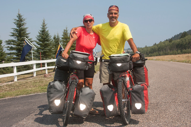 Annelies Solomon and her husband Hannes Salomon on Red Rock Road in Island Park, Idaho. They are on a four year journey (and honeymoon), of which this is about mile 25,000 in year three.  Starting in Austria and traveling to Spain before flying to Chile  and riding to Patagonia at the very tip of South America, they are now on their way to Edmundton, AB, Canada,  up the spine of the Americas  before flying back to South America and then to New Zealand. They are from Austria and Switzerland. Aug 12, 2012.