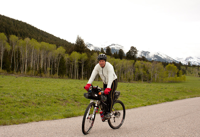 Jeffrey Tomassetti from Fernandina Beach, FL on Red Rock Road with the cloud covered eastern Centennial Mountains in the background. Jeffrey is competing in the Tour Divide race for 2011. June 17, about 10:30 AM.