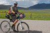 Jon Billman with Henry's Lake, near RedRock RV Park and Island Park, Idaho in background. Jon is participating in the Tour Divide (2700 miles from Banff to Mexican border). Time about 4:45PM on June 20, 2010.