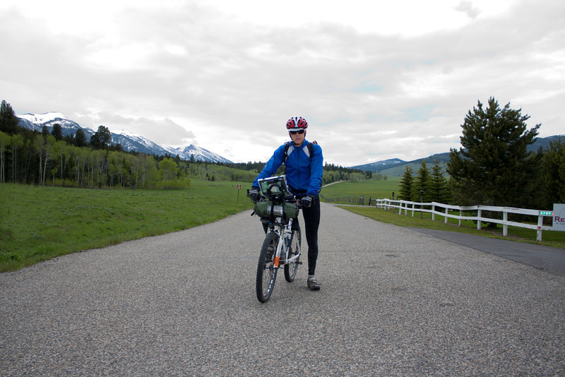 Kim Raeymaekers from Belgium is riding the Tour Divide Mountain Bike race between Banff, AB, Canada and Antelope Springs, New Mexico at the Mexican border. He is on Red Rock Road in Island Park, Idaho on June 17, 2011. The Centennial Mountains and continental divide are in the background.