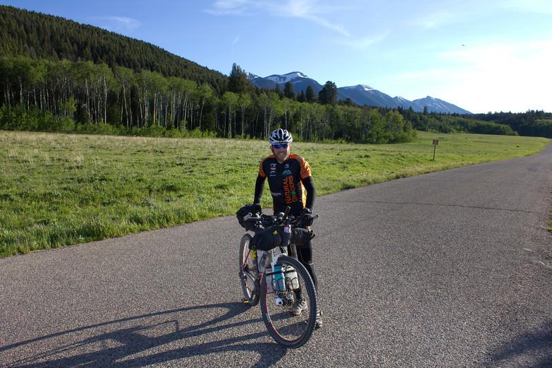 Garrett Peltonen  along Red Rock Road with Centennial Mountains behind him in the Tour Divide race. June 14, 2012.
