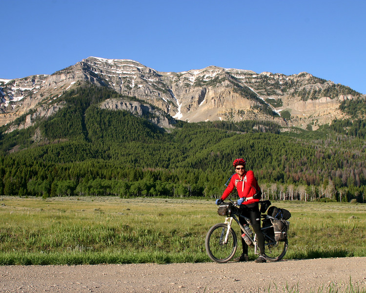 John Billman, from Stillwater, OK, in front of the Western Centennial Mountains along Red Rock Road in the Red Rock Lakes National Wildlife Refuge. He is taking part in the Great Divide Race, the world's longest non-stop mountain bike race!