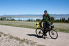Eric Bruntjen, Tour Divide participant along Red Rock road with Upper Red Rock Lake in the Red Rock Lakes National Wildlife Refuge on June 18, 2010.