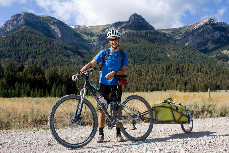 Scott Richard Felter is traveling the Great Divide Mountain Bike Route. Here he is in the Red Rock National Wildlife Refuge with the West Centennial mountains in the background on August 26, 2008. He began August 6th from his home town of Banff in Canada and plans to reach Mexico by 1st of October.