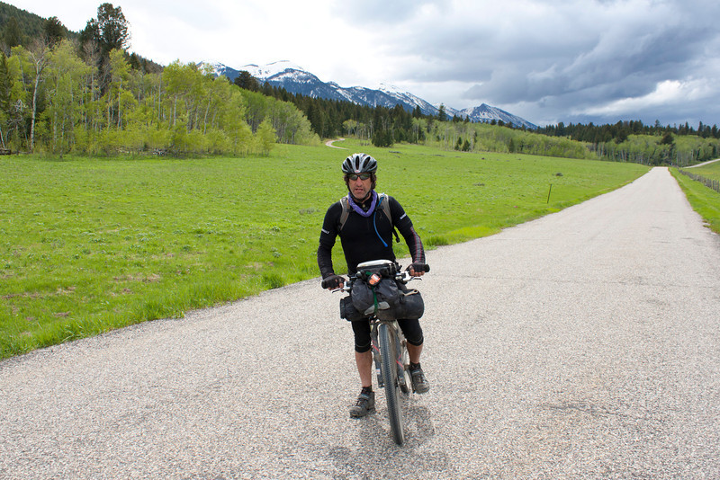 David Goldberg along Red Rock Road with eastern Centennial Mountains in the background. David is a veteran of the Tour Divide Race. He is a contestant in the 2011 race that started June 10 from Banff, Alberta, Canada. This year the course has been modified from the past due to the late snows.  June 16, 2011, about 4:30 PM.
