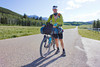 Christopher Bennett from New Zealand poses along Red Rock Road in front of the Centennial Mountains of Idaho while racing in the Tour Divide Bicycle Race. He accomplished the 1009 mile mark here on his way to the finish at mile 2720. June 18,