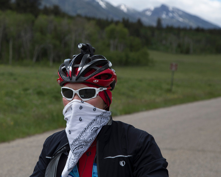 Markley Anderson from Virginia is riding the Tour Divide Bicycle Race from Banff, Alberta, Canada to Antelope Springs, New Mexico (Mexico/USA border). He has stopped for a photo in front of the Centennial Mountains in Idaho at RedRock RV Park. He is sporting his bandito look here. June 20, 2013.