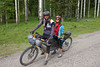 Caroline Soong and Kurt on their Tandom Bike along the Tour Divide Bicycle Race route on Red Rock Road near Island Park, Idaho. June 15, 2012.