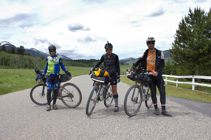 Dylan Taylor, Katherine Wallace and Josh Shifferly pose in front of RedRock RV Park on their 2700 mile journey along the Continental Divide in the Tour Divide Race. June 15, 2012.