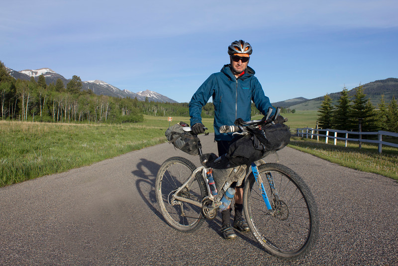 Robin Borstmayer of Banff, Alberta, Canada along Red Rock Road during the Tour Divide Bicycle race at mile 1008. June 16, 2012.