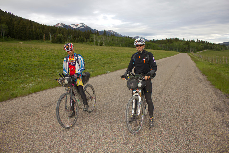 Max Morris from Tucson, AZ and  Erik Goedhart  of New Paltz, NY pause in front of the Centennial Mountains near Island Park, Idaho on their bid for the honors in the Tour Divide Bicycle Race from Banff, AB to the Mexican border (2720 miles). June 17, 2012