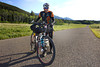 Garrett Peltonen from Colorado poses in front of the East Centennial Mountains along Red Rock Road near Island Park, Idaho on his way south in the Tour Divide mountain bike race on June 14, 2012.
