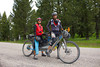Kurt Refsnider, and Caroline Soong on their Tandem on Red Rock Road along the Tour Divide Route. June 15, 2012. Island Park, Idaho