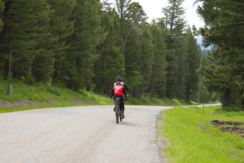 Caroline Soong and Kurt Refsnider coast down Red Rock Road on their way to Antelope Springs, New Mexico and the Mexican Border on their Tandem bike as part of the Tour Divide Bicycle Race. June 15, 2012.