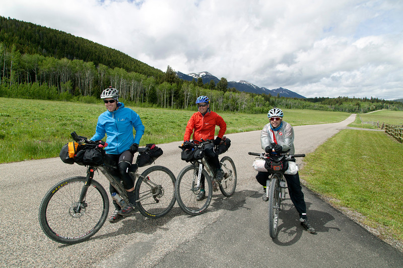 Nick Hutton (Noosa, Australia), Nathan Mawkes (Auckland, New Zealand) and Nick Legan (Boulder, CO) in front of RedRock RV Park near Island Park, Idaho during their race on the Tour Divide Bicycle race on June 22, 2013.