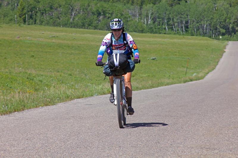 Michelle Dulieu of Rochester, NY is bringing up the rear, almost, along Red Rock Road in Idaho. One more behind her, but she's still determined to finish the Tour Divide bicycle race from Banff, AB, Canada to the Mexican border in Mexico! June 22nd, 2012.