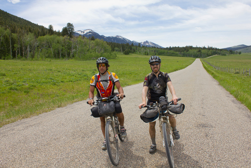 Mark Farnsworth, (North Carolina) and David Goldberg (Colorado) pause on Red Rock Road in Idaho with the Centennial Mountains in the background. They are at mile 1008 of their 2720 mile trek on the Tour Divide Bicycle Race. June 16, 2012