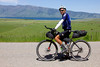 Chip Andrus, from Corvallis, Oregon is northbound with Henry's Lake of Idaho in the background. He's racing for Canada in the Tour Divide Bicycle race. June 22nd, 2012