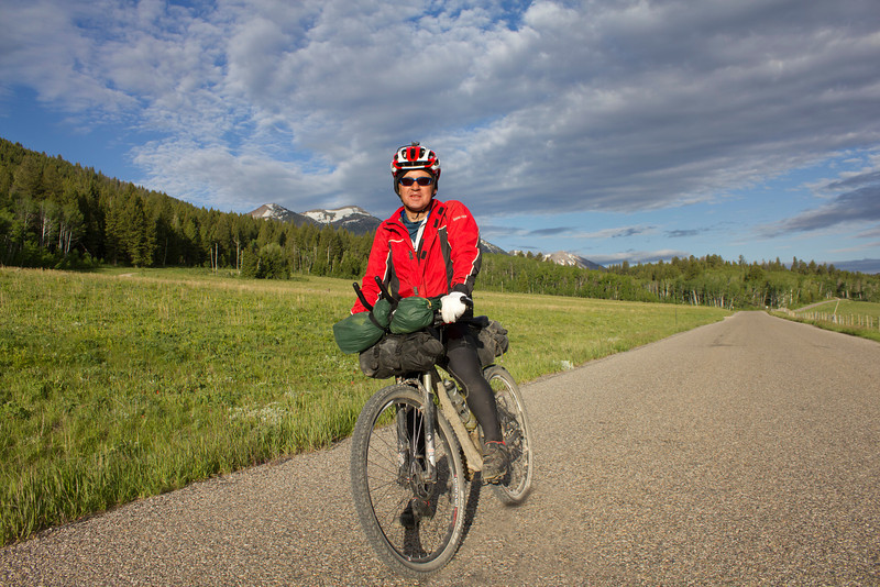 John Phillips pauses for a photograph with the Centennial Mountains as a backdrop along Red Rock Road in Island Park Idaho on his Tour Divide Bicycle Race on June 17th, 2012 outside RedRock RV Park. John is from the United Kingdom (Winchester).