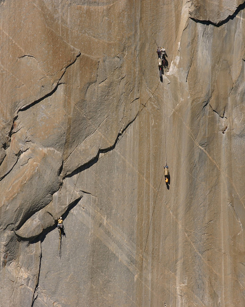 Two rock climbers hang from the face of El Captain in Yosemite National Park.