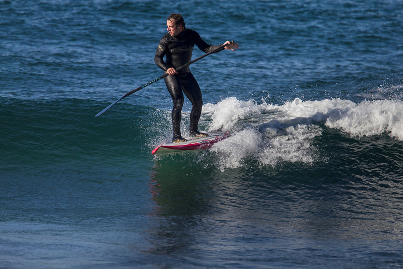 Stand-up paddle surfing at Kiwanda Beach in Pacific City,, OR. One guy told me that the sport did wonders for his balance and let him gain more speed paddling for a wave. He also said that it made it far easier to spot sharks. Oct 25, 2012