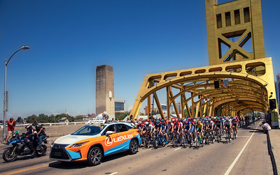 Riders head over Sacramento's Tower Bridge after starting the 2019 Amgen Tour of California in downtown Sacramento a few blocks away.