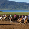 Kids from the Meadow Vue Ranch near Island Park Idaho during the Rodeo they give 3 nights a week. The kids attend a multi-week camp learning more about ranching and cow handling at the ranch. June 21, 2012.  Henry's Lake in the background.