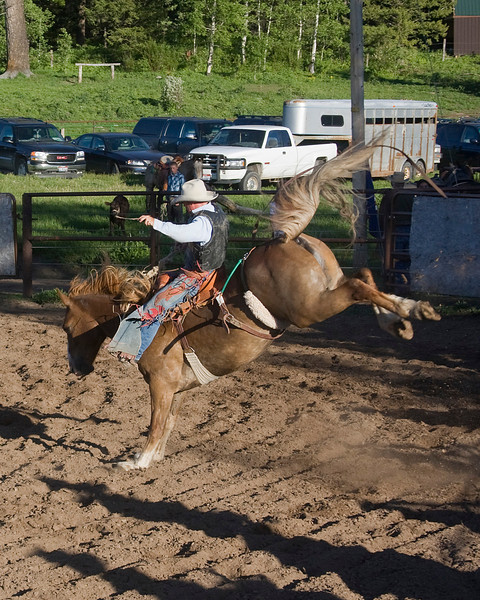 Cowboy with bucking horse at first Meadow Vue Ranch Rodeo on June 24, 2009. Island Park, Idaho near Henry's Lake.