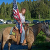 Rodeo girl showing the American Flag prior to the start the first rodeo of the season for Meadow Vue Ranch, near RedRock RV Park in Island Park, Idaho. June 24, 2009