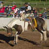 Bucking horse has all four feet off the floor at Meadow Vue Ranch Rodeo near Island Park, Idaho on June 21, 2012.