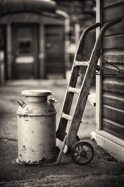 Old Milk Can with a Hand Barrows at a Train Station