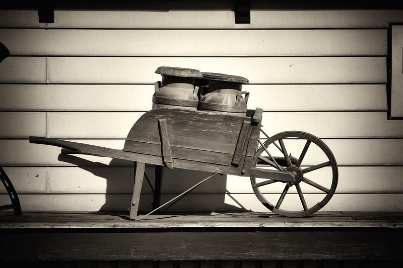 Milk Jugs in A Wheelbarrow