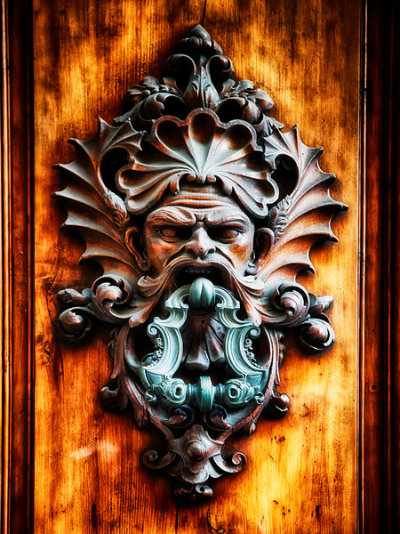 Close Up View of a Angry Man Face Door Knocker, Florence, Tuscany, Italy